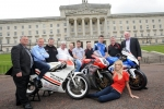 Dundrod & District Motorcycle Club members with Brian Reid, Bruce Anstey, William Dunlop, Conor Cummins and Ulster Grand Prix girl April Linton at the launch of the 90th McKinstry Skip Hire Ulster Grand Prix at Parliament Buildings