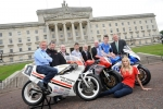 Bian Reid, Bruce Anstey, Mayor of Lisburn Alderman William Leathem, William Dunlop, Councillor Thomas Beckett, Noel Johnston, Conor Cummins and Councillor Pat Catney with Ulster Grand Prix girl April Linton at the launch of the 90th McKinstry Skip Hire Ulster Grand Prix at Parliament Buildings
