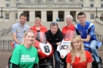 William Dunlop, Bruce Anstey and Conor Cummins and Ulster Grand Prix girl April Linton with Maria McGleenon, Heather Monteverde and Winnie McCausland from Macmillan Cancer Support at the launch of the 90th McKinstry Skip Hire Ulster Grand Prix at Parliament Buildings