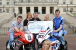 William Dunlop, Bruce Anstey, Conor Cummins and Ulster Grand Prix girl April Linton with Anne McRoberts and Heather Miller from Marie Curie Cancer Care at the launch of the 90th McKinstry Skip Hire Ulster Grand Prix at Parliament Buildings