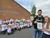 Primary school scores top marks in Aer Lingus art competition  MEADOW Bridge Primary School, Hillsborough is celebrating after P7 pupil Rachel Wood was crowned the winner in a special art competition launched by Aer Lingus and the Metzeler Ulster Grand Prix.    The competition challenged P7 students across Northern Ireland to use their imagination and artistic talent to design a new t-shirt for the Aer Lingus Mascot, Rover the Flying Clover to wear during Bike Week at the Metzeler Ulster Grand Prix.   As part of her prize, Rachel and her class received a visit from Rover the Flying Clover and leading racer Glenn Irwin, and they were all presented with t-shirts printed with the winning design.   Pictured is Rachel receiving her prize from Glenn Irwin in front of her classmates, along with School headmaster, Paul Good, Noel Johnston, Clerk of the course at the Metzeler Ulster Grand Prix and Rover the Flying Clover .