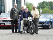 Pictured at the launch of the 3rd August UGP Bike Week event being held at Lagan Valley LeisurePlex are: (l-r) the Mayor, Councillor Thomas Beckett; Ken Stewart, Secretary of Dundrod and District Motorcycle Club; Alderman Paul Porter, Chairman of the Council's Leisure & Community Development Committee and Sammy Spence, Chairman of Lisburn City Old Vehicle Club.  The motorcycle in the photo was ridden at the UGP by former road racer Anges Martin.