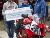 Cheque mate: Noel Johnston, UGP Clerk of the Course, with William Dunlop, Joey's son Gary Dunlop and Russell Shiels.